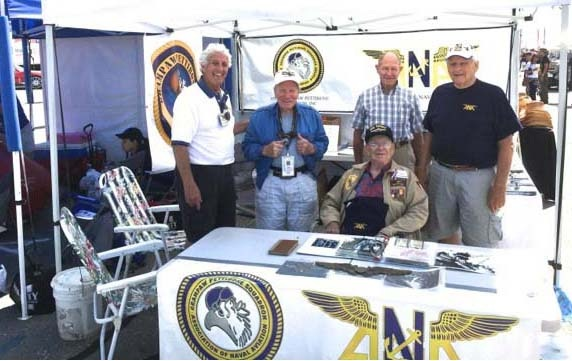 "Gramps mans recrument booth at Chino POF. L-R: Tim Brown, Fran Pieri, Peter Cherbak, Ray LeCompte. Center, front: Robert ""Jack"" Cocks, VB-11 WWII"
