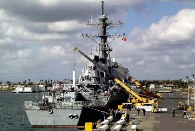 An Arleigh Burke class destroyer recieveiving its ordance loadout at NWS CDR Erik Franzen Seal Beach